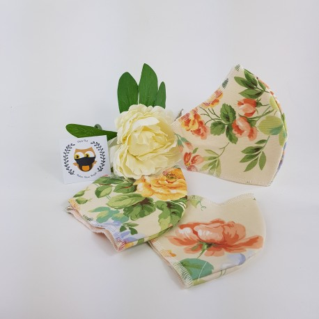 Peach floral fabric face covering